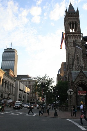 Here sits the Prudential tower to the right and the old church to the left. All is still at peace as the day ends, with the pride flag hanging gently on the church as the sun sets.