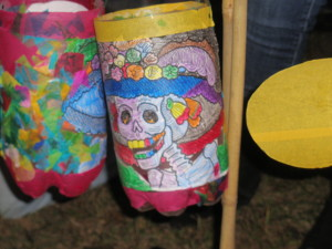 A festive skeleton, reminiscent of Dia De Los Muertes, adorns a lantern
